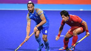 Sardar Singh of India #8 fights for the ball against Kenji Kitazato of Japan #11 during Men's Hockey Pool A Preliminary Round match between Japan and India on day six of the Asian Games on August 24, 2018 in Jakarta, Indonesia.(Getty Images)