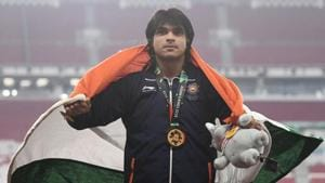 Gold medallist Neeraj Chopra celebrates during the victory ceremony for the men's javelin throw event during the 2018 Asian Games in Jakarta.(AFP)
