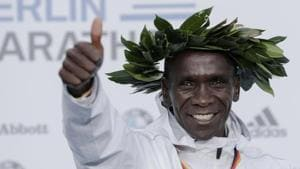Gold medalist Eliud Kipchoge celebrates during the winning ceremony for the 45th Berlin Marathon in Berlin.(AP)