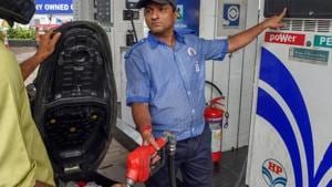 Mumbai: An employee shows the revised prices of petrol and diesel to a customer at a fuel station, as the fuel prices prices continued their record-breaking run, in Mumbai, Friday, September 7, 2018.(PTI)