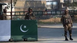 Pakistani soldiers stand guard outside central jail where an anti-terrorist court gave a verdict against suspects accused in a blasphemy lynching case in Haripur district on February 7.(AFP File Photo)