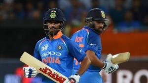 Indian cricket team captain Rohit Sharma (R) and Shikhar Dhawan runs between the wickets during the one day international (ODI) Asia Cup cricket match between Pakistan and India at the Dubai International Cricket Stadium in Dubai(AFP)