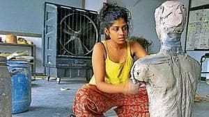 A student works on a sculpture at visual arts department in fine arts faculty at Rajasthan University.(HT Photo)