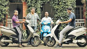 (From left to right) Vaibhav Kankhar, Class 10 student; Edward Pereira, owner, Dutch Palace; Edward's manager Ravi Kankhar and Edward's son Nathan Pereira with their electric bikes at Dutch Palace on Monday.(Saumya James/HT PHOTO)