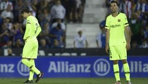 Barcelona's Spanish defender Gerard Pique (L) and Barcelona's Spanish midfielder Sergio Busquets react to Leganes' second goal(AFP)
