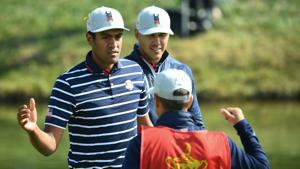 US golfer Brooks Koepka (C) and US golfer Tony Finau (L) celebrate after victory in their fourball match on the first day of the 42nd Ryder Cup at Le Golf National Course at Saint-Quentin-en-Yvelines, south-west of Paris on September 28, 2018.(AFP)