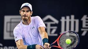 Andy Murray of Britain hits a return during his men's singles match against Fernando Verdasco of Spain at the ATP Shenzhen Open tennis tournament.(AFP)