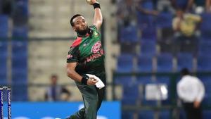 Bangladesh player Shakib Al Hasan bowls during the one day international (ODI) Asia Cup cricket match between Afghanistan and Bangladesh.(AFP)