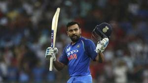 Dubai: India's captain Rohit Sharma raises his bat and helmet to celebrate scoring a century during the one day international cricket match of Asia Cup between India and Pakistan in Dubai.(AP)