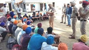 Police officials interacting with the drug addicts freed from de-addiction centre at Samrala near Ludhiana.(HT Photo)