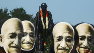 Students and volunteers wear masks of Mahatma Gandhi during a march to celebrate his 150th birth anniversary in Kolkata on October 2.(AFP)