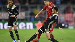 Bayern Munich's Polish forward Robert Lewandowski (right) vies for the ball with Ajax's Moroccan defender Noussair Mazraoui (centre) in Munich.(AFP)