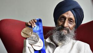 Hardev Singh Flora won a gold in 80m hurdles, silver in 200m hurdles and bronze in triple jump in the 85 to 89-year category in Malaga.(HT Photo)