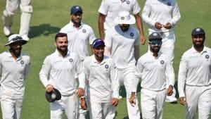 (front L-R) Indian cricketers Ravindra Jadeja, Virat Kohli, Kuldeep Yadav, Ajinkya Rahane and Cheteshwar Pujara walk back after winning the first Test cricket match between India and West Indies at the Saurashtra Cricket Association Stadium in Rajkot.(AFP)