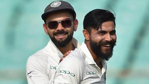 Ravindra Jadeja (R) celebrates the wicket of West Indies batsman Sunil Ambris in Rajkot.(PTI)