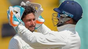 Kuldeep Yadav (L) celebrates the wicket of Shai Hope during the first Test between India and West Indies.(PTI)