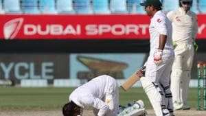 Pakistan cricketer Haris Sohail (L) gestures as he celebrates his century (100 runs) during day two of the first Test match in the series between Australia and Pakistan at Dubai International Stadium in Dubai on October 8, 2018.(AFP)