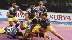 Chennai: Players of Tamil Thalaivas (Yellow Blue) and Patna Pirates (Yellow Green) in action during their opening match of Pro Kabaddi league season6 in Chennai, Sunday, Oct. 7, 2018. (PTI Photo/R Senthil Kumar)(PTI10_7_2018_000165A)(AP)