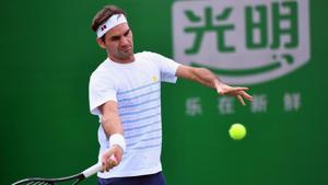 Roger Federer of Switzerland hits a return as he takes part in a training session at the Shanghai Masters tennis tournament.(AFP)