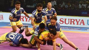 Chennai: Players of Tamil Thalaivas (Yellow Blue) and Patna Pirates (Yellow Green) in action during their opening match of Pro Kabaddi league season6 in Chennai, Sunday, Oct. 7, 2018.(PTI)