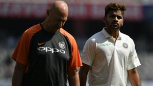 Indian cricketer Shardul Thakur (R) walks back with physio during the first day's play of the second Test cricket match between India and West Indies(AFP)