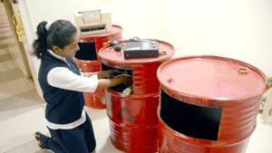 A school student puts e-waste in a drum to be reused on International E-Waste Day at Sadhu Vaswani International School Sanpada in Navi Mumbai.(HT Photo)