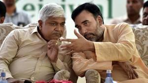 Delhi ministers Rajendra Pal Gautam (L) and Gopal Rai speak during a function in the national capital.(Sonu Mehta/HT PHOTO)