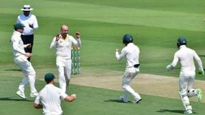Nathan Lyon (second from left) celebrates after dismissing a Pakistan batsman at the Abu Dhabi Cricket Stadium.(AFP)