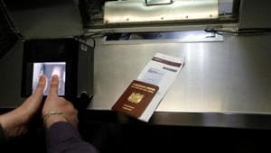 A man has his fingerprints electronically taken while taking part in a visa application demonstration at the consular section of the Embassy of the United States in Lima.(Reuters)