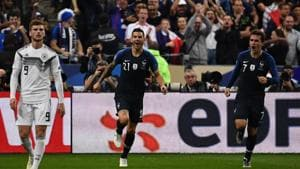 France's forward Antoine Griezmann (R) celebrates after scoring during the UEFA Nations League football match between France and Germany at the Stade de France in Saint-Denis, near Paris )(AFP)