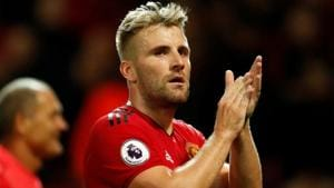 Manchester United's Luke Shaw applauds fans after the match.(Action Images via Reuters)