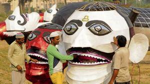 Muslim artistes giving final touches to effigies on Thursday for Dussehra celebrations on Friday in Patiala.(HT Photo)