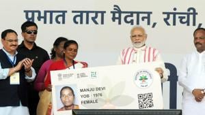 Prime Minister Narendra Modi gives a health card to beneficiaries as he launches Ayushman Bharat-National Health Protection Scheme, in Ranchi, September 23(Parwaz Khan/ Hindustan Times)