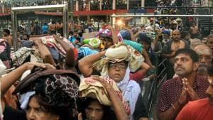 Devotees arrive to pay obeisance at Lord Ayyappa Temple in Sabarimala even as protesters keep women aged between 10 and 50 away despite the Supreme Court order.(PTI Photo)