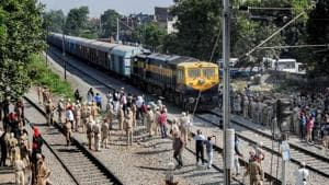 Security on high alert as the first train passes by before resumption of railway services since the train accident, in Amritsar, Sunday, Oct 21, 2018.(PTI)