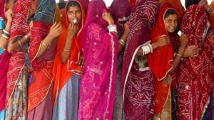 Women wait in a queue to cast their votes at a polling station in Ajmer district of Rajasthan.(REUTERS FILE PHOTO)