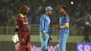 West Indies' Shai Hope, left, walks past India's Mahendra Singh Dhoni, center, and Umesh Yadav after the second one-day international cricket match.(AP)