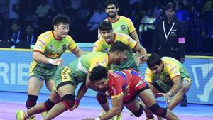 Chennai: Patna Pirates (Green Yellow) players in action against UP Yoddha during their Pro Kabaddi league.(AP)