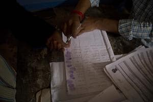 A woman whose name was left out in the National Register of Citizens (NRC) draft gives thumb impression when she submits her form and documents at a NRC center on the outskirts of Gauhati on August 13.(AP File Photo)
