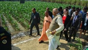 Chief minister Yogi Adityanath looking at some of the exhibits at Krishi Kumbh 2018 in Lucknow.(HT Photo)