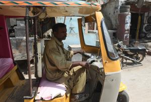 Pakistani rickshaw driver Mohammad Rasheed is just the latest victim of a money laundering scheme that Pakistan's new prime minister Imran Khan has vowed to crush.(AFP Photo)