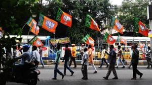 BJP activists shout slogans in support of the publication of the first complete draft of the National Register of Citizens (NRC) during a rally in Kolkata on August 2.(AFP Photo)
