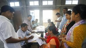 People whose names were missing in the final draft of National Register of Citizenship (NRC) published on July 30, 2018, filling new enrollment forms at an NRC Seva Kendra in Guwahati on Aug 11.(PTI/File)