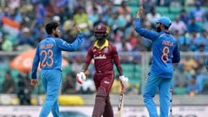 Indian bowler Kuldeep Yadav (L) and Ravindra Jadeje celebrate the dismissal of West Indies batsman Keemo Paul (C) during the fifth one day international (ODI) cricket match between India and West Indies at the Greenfield International Stadium in Thiruvananthapuram.(AFP)