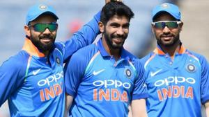 India bowler Jasprit Bumrah (C) celebrates with captain Virat Kohli (L) and Shikhar Dhawan after taking the wicket of West Indies cricketer Kieran Powell during an ODI.(AFP)