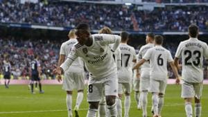 Real Madrid's Vinicius Junior bows to the crowd as he celebrates scoring his side's1st goal during a Spanish La Liga soccer match between Real Madrid and Valladolid at the Santiago Bernabeu stadium in Madrid.(AP)