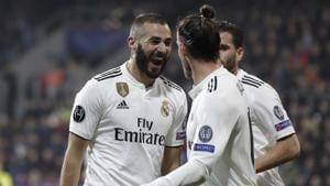 Real forward Karim Benzema, left, celebrates after scoring his side's third goal during the Champions League group G soccer match between Real Madrid and Viktoria Plzen.(AP)