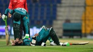 Pakistan cricketer Fakhar Zaman checks his teammate Pakistan cricketer Imam Ul-Haq as he lies on the pitch after being hit by a ball during the second one day international (ODI) cricket match between Pakistan and New Zealand(AFP)