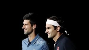 Roger Federer (R) could win 100 titles should he manage to win in London.(AP)