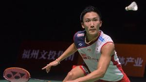 Kento Momota of Japan hits a return against Chen Long of China during their men's singles semi-final match at the China Open 2018 Badminton Championships in Fuzhou, in China's eastern Fujian province on November 10, 2018.(AFP)